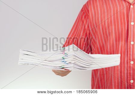 Man Hold Pile Report Have Blur Man With Red Shirt