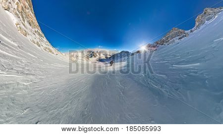 Wide-angle View Of A Mountain Hiker To Climb A Mountain Of Snow Couloir