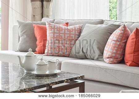 Tea Set On Marble Top Table And Lively Sofa Set