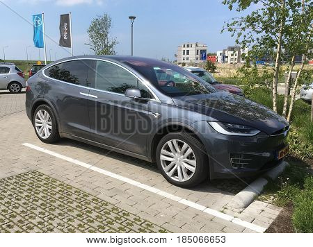 Almere, The Netherlands - May 6, 2017: Tesla model X parked in a public parking lot. Nobody in de vehicle.