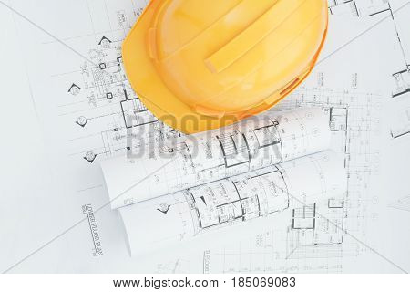 Architects Workplace - Architectural Blueprints With Measuring Tape, Safety Helmet And Tools On Tabl