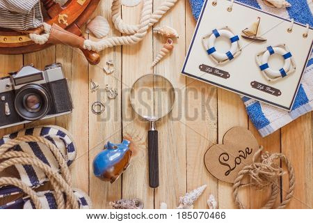 Striped Slippers, Towel, Piggy Bank, Camera And Maritime Decorations, Top View