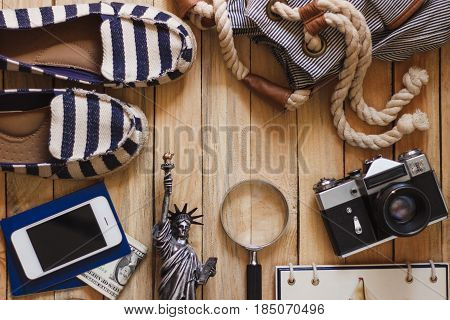 Striped Slippers, Camera, Phone And Miniature Of The Statue Of Liberty