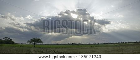 Afternoon at a countryscape farm with  magnificient clouds.