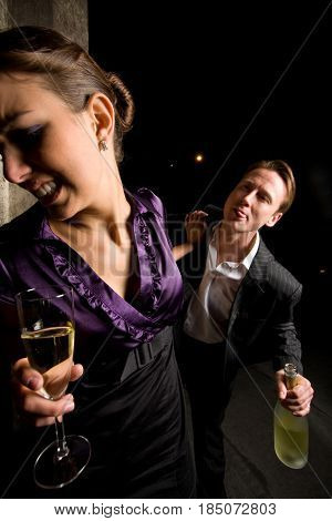 young lady rejecting a drunk weirdo hitting on her on a new-year's party