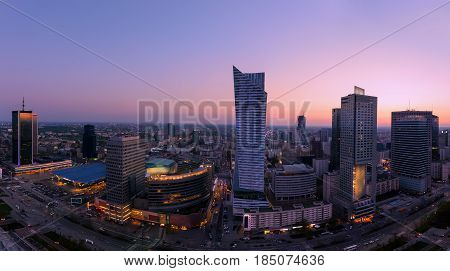 Panorama of Warsaw city with modern skyscraper after sunset Poland Europe.