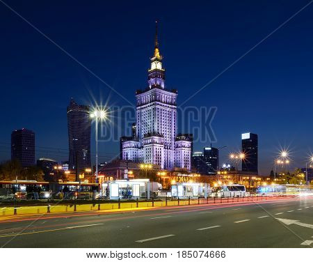 Palace of Culture and Science and downtown business skyscrapers in the evening