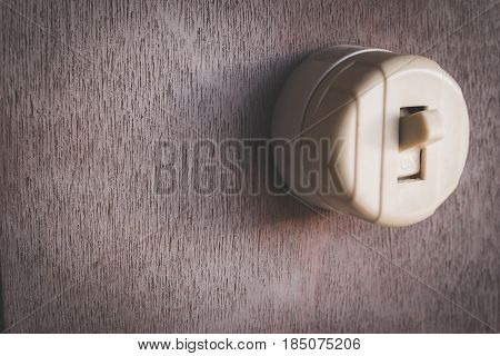 Old Classic Vintage Electric Switch On Old Wooden Wall With Copy Space For Text. Old Switch On Wall