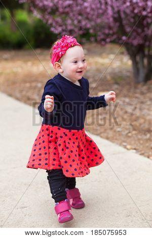Adorable Baby Learning Balance