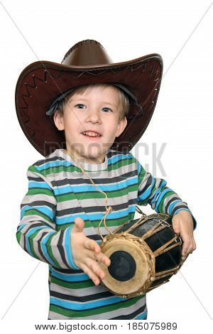 Emotional kid beats the drum isolated on white