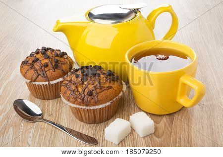 Muffins With Chocolate, Yellow Teapot, Cup Of Tea, Lumpy Sugar