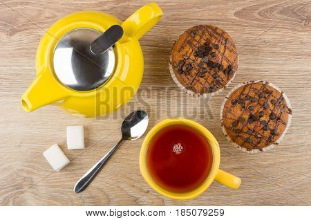 Muffins, Yellow Teapot, Cup Of Tea, Lumpy Sugar And Spoon