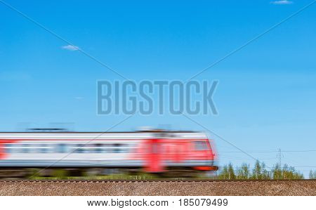 Highspeed train moves on the hill on blue sky background