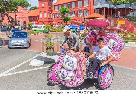 MALACCA, MALAYSIA - AUGUST 12, 2016: The decorated trishaw parking in Dutch Square Malacca tourists and local people can seen around the Dutch Square Malacca