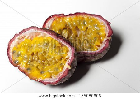 passion fruits cut in halves on white background