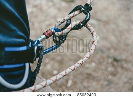 Female climber in harness with rope and figure eight.