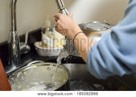 Closeup On Woman's Hands Washing Dirty Dishes