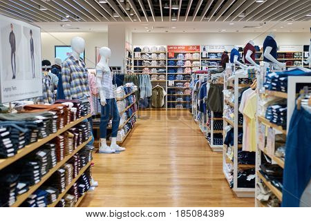 SINGAPORE - CIRCA SEPTEMBER, 2016: inside Uni Qlo store at Singapore Changi Airport. Uniqlo Co., Ltd. is a Japanese casual wear designer, manufacturer and retailer.