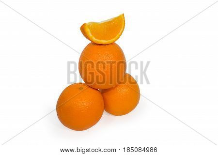 Three oranges and slice isolated on white background.