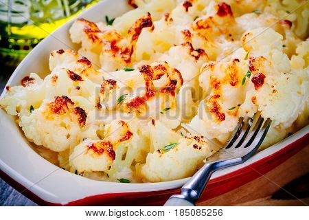 Cauliflower And Cheese Gratin In The Baking Dish Closeup