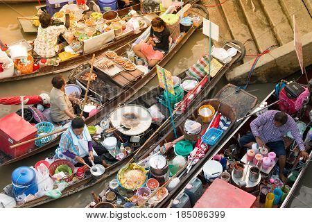 Samut Songkhram, Thailand - May 2, 2017: Amphawa Floating Market With Wooden Boats Busy Ferrying Peo