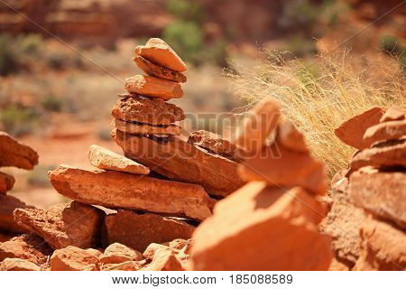 Rock cairns constructed by hikers in the desert.