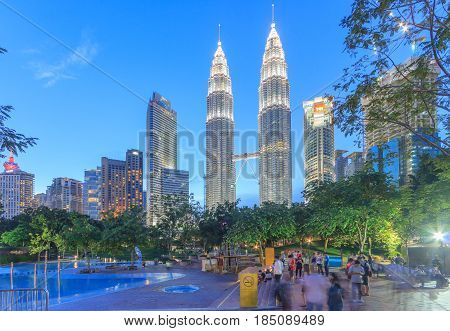 KUALA LUMPUR, MALAYSIA - AUGUST 13: Petronas Twin Towers at night on August 13, 2016 in Kuala Lumpur. Petronas Twin Towers were the tallest buildings (452 m) in the world from 1998 to 2004.