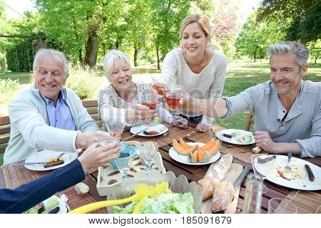 Family having summer lunch in garden