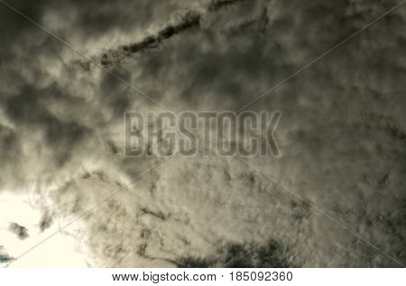 Thickened and twisted spindrift clouds covered sky dark hurricane clouds