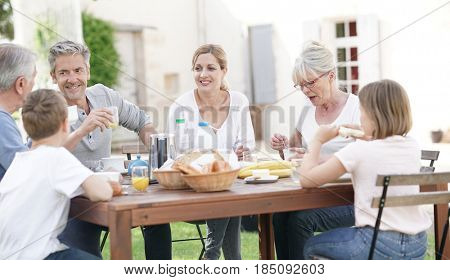 Family having breakfast together in holiday home