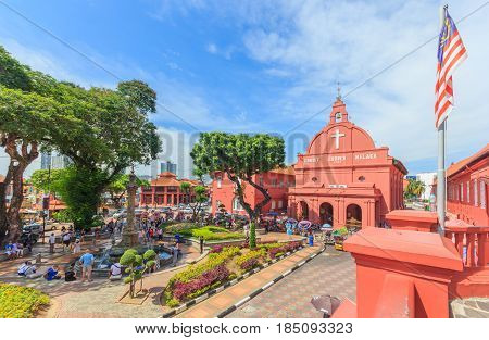 MALACCA MALAYSIA - AUGUST 122016: A view of Christ Church & Dutch Square on August 12 2016 in Malacca Malaysia. It was built in 1753 by Dutch & is the oldest 18th century Protestant church in Malaysia.