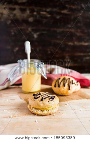 Wheat scones or cookies with dark chocolate and lemon curd, selective focus