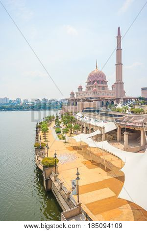 PUTRAJAYA, MALAYSIA - AUGUST 15, 2016: Putra Mosque at Putrajaya Malaysia. Putra Mosque is a modern mosque which can accommodate several thousands of prayers at one time.