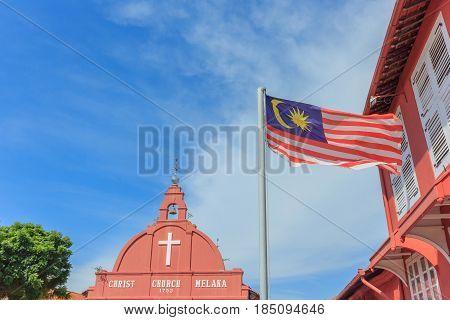 MALACCA, MALAYSIA - AUGUST 13, 2016: Malaysian national flag on a pole against blue sky