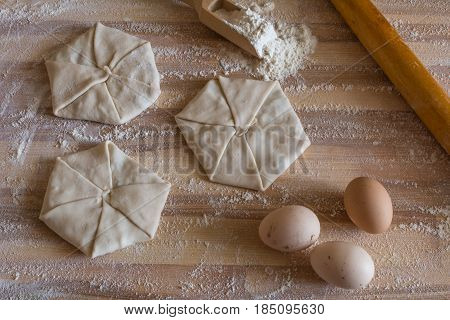 Pastries With Cheese, Domestic Eggs, Wooden Rolling Pin On A Wooden Board