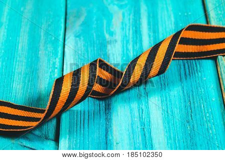 George Ribbon In Hands. Symbol Of May 9 - George Ribbon Striped, Orange And Black . Memory Soviet Vi