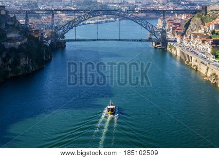 Douro River view with famous bridge of Dom Luis I connected cities of Porto and Vila Nova de Gaia (left) Portugal