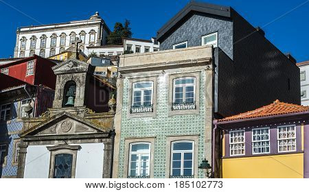 Twonhouses and small Lada Chapel and houses in Ribeira district Porto Portugal