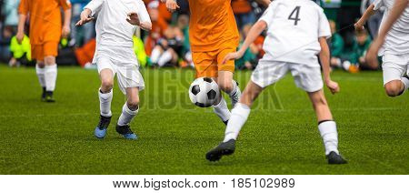 Youth Soccer Match. Young Footballers Kicking Soccer Game. Young Soccer Players Running After the Ball. Horizontal Sports Football Background