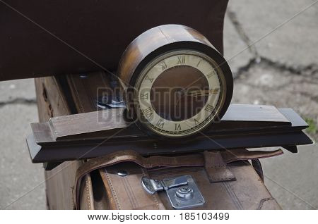 Spring in the park on an old suitcase wooden mantel retro clock