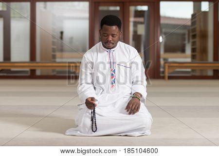 Young African Muslim Guy Praying