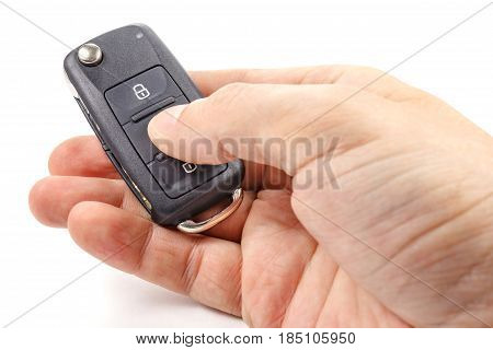 Man's hand presses button on the ignition key