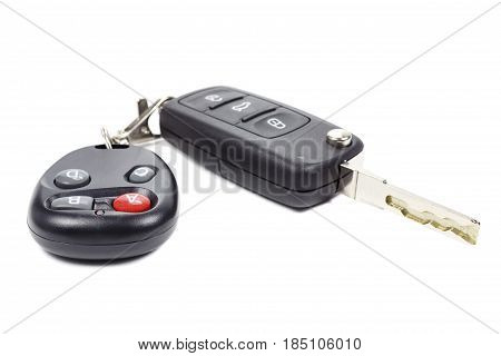 Ignition key and garage door remote control on a white background