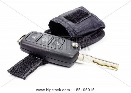 Ignition key with storage pouch on a white background