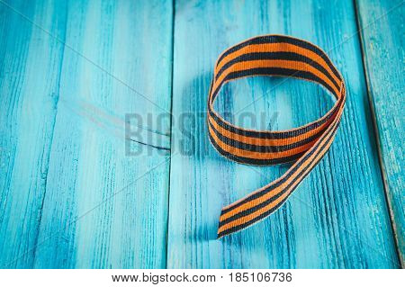 Red Carnations And St. George Ribbon On Wooden Background St. George Ribbon - The Symbol Of The Grea