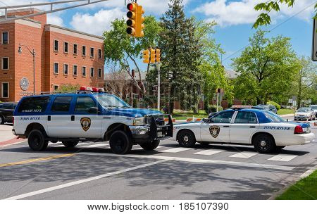 Toms River NJ USA -- May 6 2017 -- Two police vehicles form a blockade at an intersection. Editorial Use Only