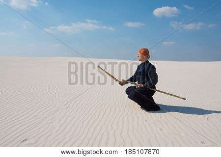 Man With Shinai In Traditional Japanese Clothes Took The Position