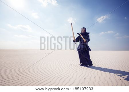 Warrior In Traditional Armor For Kendo Ready For A Fight