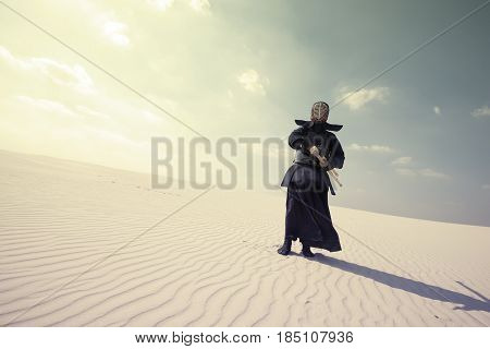 Warrior In Traditional Armor For Kendo In A Desert
