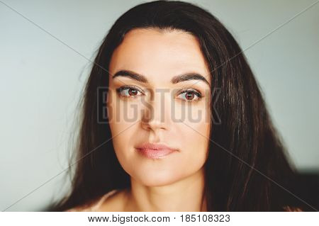 Close up portrait of 35-40 year old woman with black hair